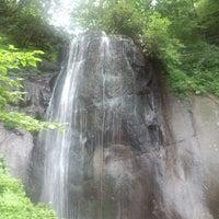 Photo taken at 有明の滝 by Hikaru T. on 8/7/2013