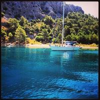 Photo taken at Olympos Plajı by Dos Plumas T. on 6/23/2013