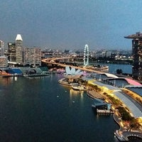 Photo taken at Marina Bay Financial Centre (MBFC) Tower 1 by Ilias C. on 12/23/2016