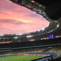 Photo taken at Olimpiyskiy Stadium by Ira P. on 7/7/2013