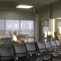 Photo taken at Gate A18 by Regent B. on 6/8/2013
