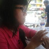 Photo taken at Menyenk Cafe by Haris K. on 9/17/2013