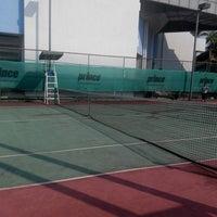 Photo taken at Gelanggang Tennis Tasik Titiwangsa by Syazli S. on 2/15/2015