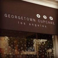 Photo taken at Georgetown Cupcake by Jennifer P. on 6/8/2013