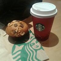 Photo taken at Starbucks by Julyenne C. on 12/16/2013