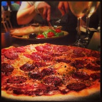Photo taken at Little Wing Pizzeria by Mike M. on 8/29/2013