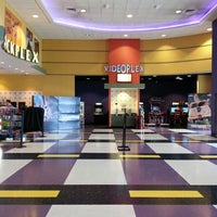 Photo taken at Starplex Cinemas Stadium 12 by K. K. on 10/28/2014