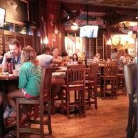 Photo taken at Margaritaville Bar & Grill by K. K. on 9/1/2013