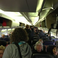 Photo taken at Gate C30 by Kevin R. on 2/10/2013