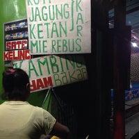 Photo taken at Jagung Bakar & Sate Kelinci by Olga L. on 12/25/2013