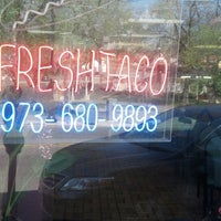 Photo taken at Happy Ming/Fresh Taco by Ross B. on 5/1/2013