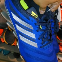 Photo taken at Adidas outlet store by Raymond B. on 4/2/2015