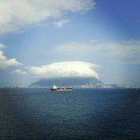 Photo taken at Gibraltar Bay by Konstantin K. on 10/9/2013