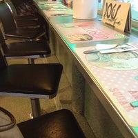Photo taken at Dog's Café by Carole F. on 6/28/2013