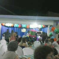 Photo taken at Brincadeiro buffet by Jamile D. on 12/21/2013