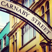Photo taken at Carnaby Street by Camila C. on 8/3/2013