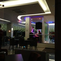 Photo taken at Limos Cafe & Restaurant by Metecan E. on 7/8/2013