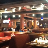 Photo taken at Red Robin Gourmet Burgers by Albert C. on 2/24/2013