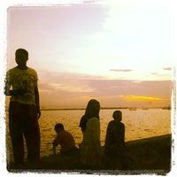 Photo taken at Taman Teratai - Kendari Beach by Asmaidar I. on 1/26/2014