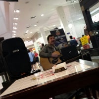 Photo taken at Livrarias Curitiba by Marcelo C. on 7/8/2013