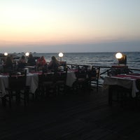 Photo taken at Calamari Restaurant by Andre M. on 6/26/2013