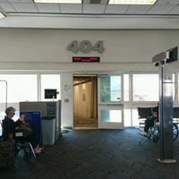 Photo taken at Gate 404 by Loland F. on 3/31/2017