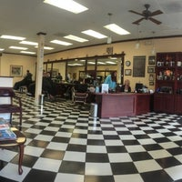 Photo taken at Gino's Classic Barber Shoppe by Paddy M. on 5/9/2014