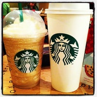 Photo taken at Starbucks by Carla Cristina S. on 12/4/2011