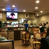 Photo taken at Delfiore Pizza & Food Co. by Troy W. on 3/18/2011