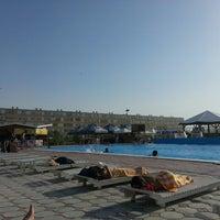 Photo taken at Aktau sweeming pool by Diana Z. on 7/8/2013