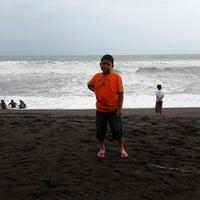 Photo taken at Pantai Kuwaru by Linda K. on 12/27/2014