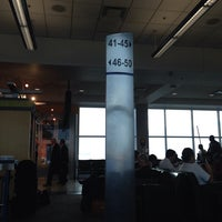 Photo taken at Gate 30 by Sally Ann on 11/12/2013