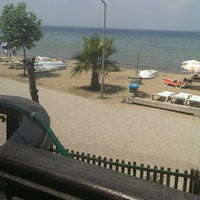 Photo taken at Palmiye Beach by asmin s G. on 7/5/2013