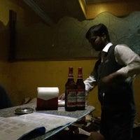 Photo taken at Reliance Bar  and Restaurant by Karunakar R. on 12/13/2014