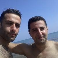 Photo taken at Işık Beach by İsa Emir T. on 10/6/2014