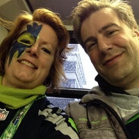 Photo taken at Metro Bus Seahawks Shuttle by Wendy M. on 1/11/2014