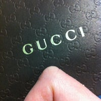 Photo taken at Gucci by Maria L. on 2/1/2014