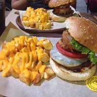 Photo taken at Just Burgers by Eleni K. on 9/8/2014