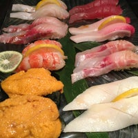 Photo taken at Ocean Blue Sushi Club by Jacky C. on 3/6/2013