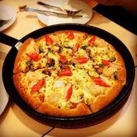 Photo taken at Pizza Hut by Jiragiti G. on 2/26/2014
