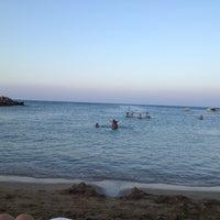 Photo taken at Pernera Beach by Panagiotis K. on 8/11/2013