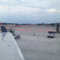 Photo taken at Gate 9 by Larry C. on 8/1/2013