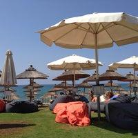 Photo taken at Mango Beach Bar by Nikolaos T. on 8/27/2013