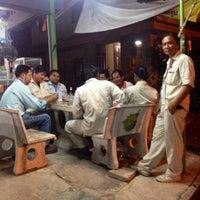Photo taken at ร้านลาบยโส วงเวียนปลาโลมา by Pim K. on 6/2/2015