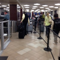 Photo taken at Terminal 2 Security Checkpoint by Shane T. on 3/1/2014