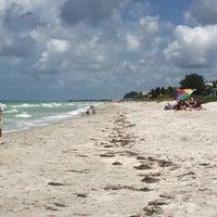 Photo taken at Longboat Key Beach by Rebecca M. on 7/4/2014