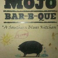 Photo taken at MOJO Bar B Que, A Southern Blues Kitchen by Tim L. on 7/20/2013