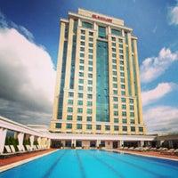 Photo taken at Marriott Hotel Asia by Deniz Tanilir on 4/6/2013