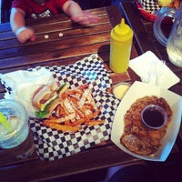 Photo taken at Bun Bun Gourmet Burger and Tea House by Joe C. on 9/29/2013