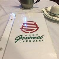 Photo taken at Gourmet Carousel by Richie W. on 3/14/2018